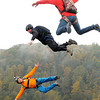 A trio of BASE jumpers takes the plunge off the New River Gorge Bridge on a foggy Saturday morning during Bridge Day 2013.  F. Brian Ferguson/The Register-Herald