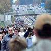 Visitors to Bridge Day 2013 were in for a long walk to the New River Gorge Bridge as rainy, cool weather did not seem to thin the crowds.  F. Brian Ferguson/The Register-Herald