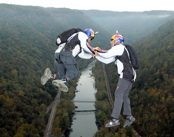 Two, Red Bull BASE jumpers  plunged off the New River Gorge Bridge, in tandem, on a foggy Saturday morning.  F. Brian Ferguson/The Register-Herald