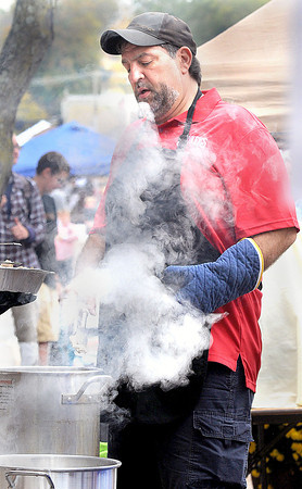 John Biafore with the Shoney's booth cooks up a pot of chicken wings during the Taste of our Town festival in Lewisburg on Saturday. F. Brian Ferguson/The Register-Herald