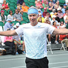 John McEnroe works the crowd during The Greenbrier Champions Tennis Classic.<br /> Rick Barbero/The Register-Herald