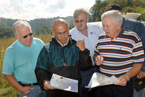Coalfield Express officials, (from left), Michiel Goode, Chairman of the Coalfield Expressway Authority, Ali Sadeghin, Regional Design Engineer for the WV Department of Highways, Senator Richard Browning, and Dave Tolliver, Raleigh County Commissoner look over maps of a section of the Coalfields Expressway, between Slab Fork Road and the Wyoming County line. F. Brian Ferguson/The Register-Herald