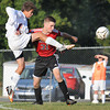Keegan Rose, of Woodrow, left, kicks the ball while being defending by, Nathan Bailey, of Nitro.<br /> Rick Barbero/The Register-Herald