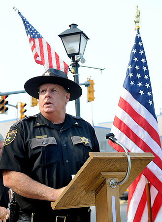 Raleigh County Sheriff Steve Tanner, speaks during a 911 ceremony at Jim Word Memorial Park on Neville Street in Beckley Wednesday morning.<br /> Rick Barbero/The Register-Herald