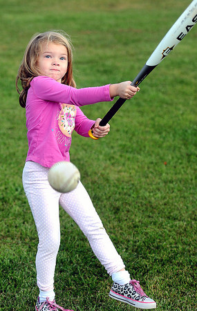 Kyndal Parsons, 5, of Fayetteville practices her swing between her mother, Chynna Parsons softball games on Saturday at the Fayetteville Little League park. Kyndal's mother plays for the Jan-Care Ambulance team which was taking part in a weekend tournament that raised funds for the Fayetteville Little League. F. Brian Ferguson/The Register-Herald