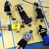 Teams do push-ups  during Saturday's FOLK program at The Place. Twenty 5-member teams competed to raise money to help feed hungry children. F. Brian Ferguson/The Register-Herald