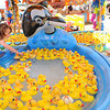 Aeryn McGraw, 2, daughter of Scott and Nancy McGraw, of Crab Orchard, grab a rubber duck for a prize at the Lucky Duck boothe at the West Virginia State Fair.<br /> Rick Barbero/The Register-Herald