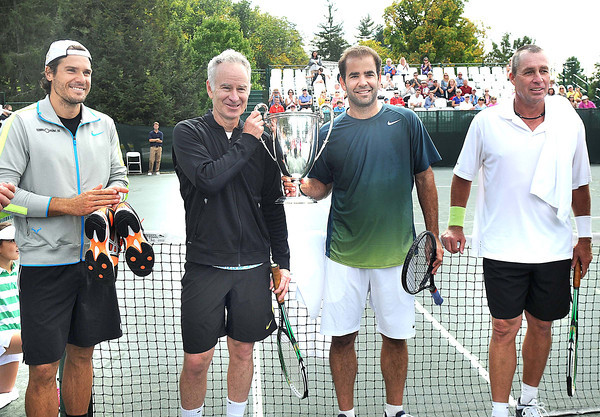 Tommy Haas, left, John McEnroe, Pete Sampras and Ivan Lendl, during the trophy presentation for the The Greenbrier Champions Tennis Classic.<br /> Rick Barbero/The Register-Herald