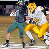Wyoming East Christian Hedinger, left, tries to get away from the grasp of Mount View's Jamari Perry, right, during action on Friday evening in New Richmond. F. Brian Ferguson/The Register-Herald