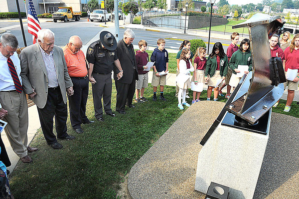 Moment of silence was observed during a 911 ceremony at Jim Word Memorial Park on Neville Street in Beckley Wednesday morning.<br /> Rick Barbero/The Register-Herald