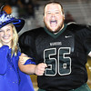 Wyoming East Seniors Chasity Brown and escort Ryan Cantrell react as Chasity's name was announced as Wyoming East's 2013 Homecoming Queen on Friday evening in New Richmond. F. Brian Ferguson/The Register-Herald