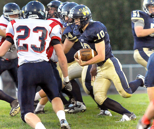 Independence's Brandon Treadway, left, tries to stop Greenbrier West RB Cory Cox, right, from picking up a big gain in Charmco on Friday evening. F. Brian Ferguson/The Register-Herald
