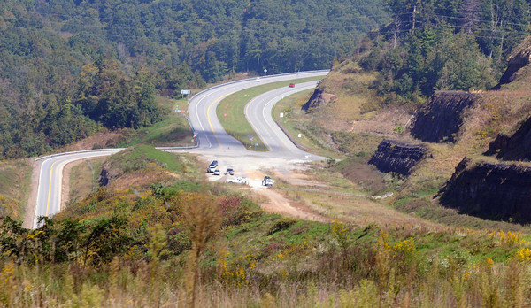 "The area where the pavement ends, at the Slab Fork exit, and the portion of the Coalfields Expressway that is completed to ""at-grade"" standards begins. F. Brian Ferguson/The Register-Herald"