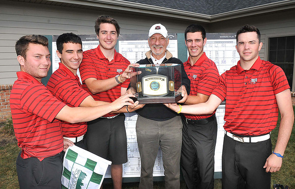 Brady Moran, left, Max Kirsch, Jack Owens, Fred Joseph, coach, Zack Kempa and Kenneth Sames, with Indiana University of Pennsylvania, were the winners of theInaugural Glade Springs Intercollegiate Golf Championship held on the Wood Haven Course.<br /> Rick Barbero/The Register-Herald