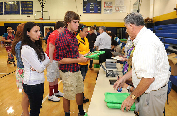 Students at Shady Spring High School receive new iPads in the school gym.<br /> Rick Barbero/The Register-Herald