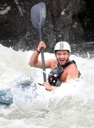 Kayaker enjoying his ride at pillow rock in the upper Gauley River during the first day of the Gauley season.<br /> Rick Barbero/The Register-Herald