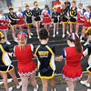 Greenbrier West and Independence cheerleaders joined in a pre-game prayer in Charmco on Friday evening. F. Brian Ferguson/The Register-Herald