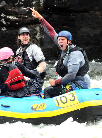 Rafters react after making it past pillow rock in the upper Gauley River during the first day of the Gauley season.<br /> Rick Barbero/The Register-Herald
