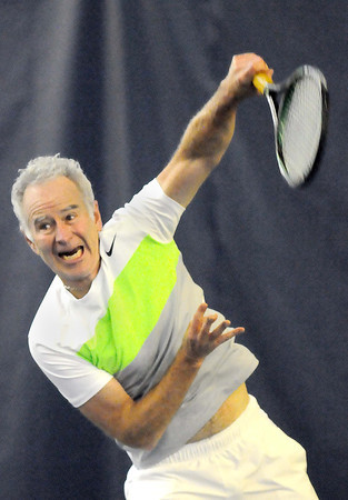 John McEnroe serves during Saturday's match against Ivan Lendl at The Greenbrier F. Brian Ferguson/The Register-Herald