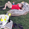 Parker Wriston, 4, and son of Clear Creek VFD Captain, Shane Wriston sneaks in a short nap during Saturday's Firefighters weekend dat the Oak Leaf Festival in Oak Hill. Long is continuing a proud family tradition of firefighting F. Brian Ferguson/The Register-Herald