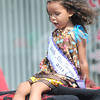 Lil Mis. Fayette County, Lylah Dearing takes in her float ride during Saturday's parade at the Oak Leaf Festival in Oak Hill. Long is continuing a proud family tradition of firefighting F. Brian Ferguson/The Register-Herald