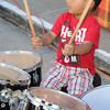 Joel Thompson, 2, of Beckley tries his skills on the drums at the School of Harmony booth during Saturday's Kid's festival in downtown Beckley.. F. Brian Ferguson/The Register-Herald