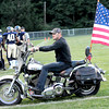 Robbie Treadway takes his motorcycle onto the field with the Greenbrier West team in Charmco on Friday evening. F. Brian Ferguson/The Register-Herald