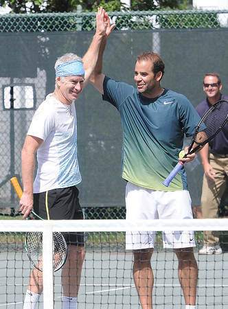 John McEnroe, left, and  Pete Sampras, high five each other after beating Ivan Lendl and Tommy Haas The Greenbrier Champions Tennis Classic.<br /> Rick Barbero/The Register-Herald