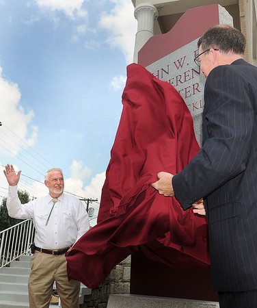 John L Eye, left, and UC-Beckley President Dr. Jerry Forster, right, unveil a new monument sign that honors the late John W. Eye during Tuesday's re-dedication of the John W. Eye building on the UC -Beckley campus.  F. Brian Ferguson/The Register-Herald