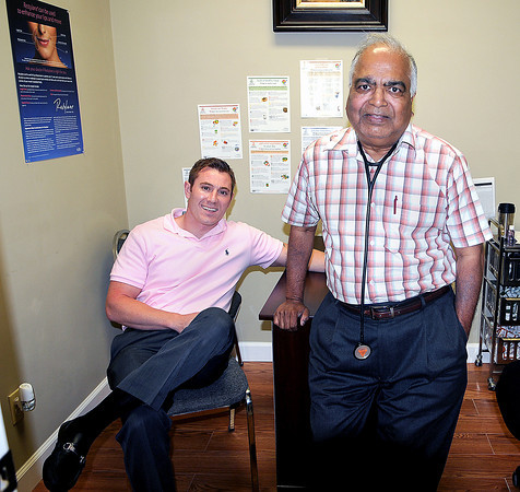 Joshua Galbraith, Owner of Transformations Weight Loss, left, and Dr. Subhash V. Gajendragadkar, right, at their office in the Plaza Mall. F. Brian Ferguson/The Register-Herald