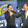 Gov. Earl Ray Tomblin, right, joins hands with Jake Steinfield, chairman of the National Foundation for Governors Fitness Councils, at Stratton Elementary School. The school recieved a brand new Live Positively TM Fitness Center.<br /> Rick Barbero/The Register-Herald