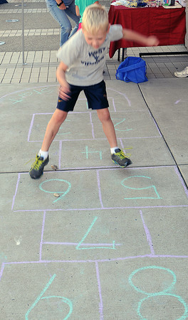 Jake Knell, 4, of Daniels, tests his skills at  hop-scotch with, during Saturday's Kid's festival in downtown Beckley.. F. Brian Ferguson/The Register-Herald