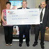 AEP Foundation has made a donation of $25,000 to Just for Kids for it's continued work in Wyoming County. (From left), Manon Wheeler with First Community Bank, David Langford with Appalachian Power, and Scott Miller with Just for Kids.F. Brian Ferguson/The Register-Herald