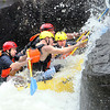Rafters reach pillow rock in the upper Gauley River during the first day of the Gauley season.<br /> Rick Barbero/The Register-Herald