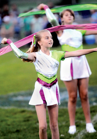 Kinsley Gwinn, front, and Alyssa Burdette, rear, both 11 years-old and members of the WV Magic Dance Team put on a show for the fans at the Meadow Bridge-Fayetteville game in Meadow Bridge. F. Brian Ferguson/The Register-Herald