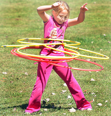 Amber Stickler, 7, makes use of every Holla-Hoop that she could get her hands on during Saturday's Layland Fall Festival, which is given by the Mullins family to treat friends and neighbors to a day of fun at the last of the summer. F. Brian Ferguson/The Register-Herald