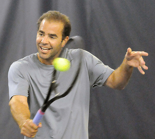 Pete Sampras hits a backhand during Saturday's tennis at The Greenbrier F. Brian Ferguson/The Register-Herald