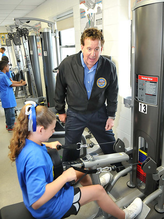 Jake Steinfield, chairman of the National Foundation for Governors Fitness Councils, works with Kayla Bird at Stratton Elementary School in the schools  brand new Live Positively TM Fitness Center.<br /> Rick Barbero/The Register-Herald
