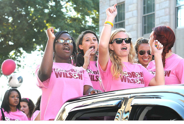 Woodrow Wilson High School girls soccer team stand in the back of a pickup truck coming down Main Street in Beckley during the homecoming parade Monday evening.<br /> Rick Barbero/The Register-Herald