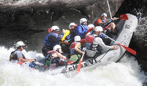 Rafters with Adventures on the Gorge/ClassVI slam into pillow rock in the upper Gauley River during the first day of the Gauley season.<br /> Rick Barbero/The Register-Herald