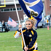 Greenbrier West  cheerleader Cianna Donaldson leads the team on the field  in Charmco on Friday evening. F. Brian Ferguson/The Register-Herald