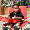 Elijah M. Green, 2, of Lester works a 6-string during Saturday's School of Harmony Creative Kids Festival in Daniels. F. Brian Ferguson/The Register-Herald