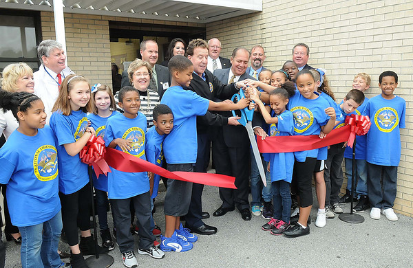 Gov. Earl Ray Tomblin and Jake Steinfield, chairman of the National Foundation for Governors Fitness Councils, cut the ribbon with students at Stratton Elementary School for the brand new Live Positively TM Fitness Center.<br /> Rick Barbero/The Register-Herald