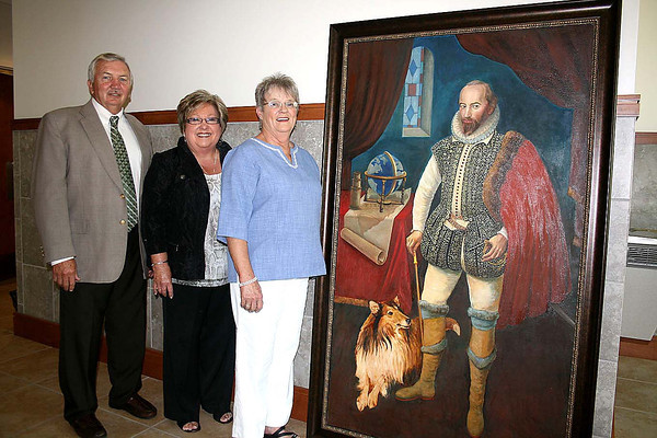 Jim Workman/For The Register-Herald<br /> Commissioners Dave Tolliver, Pat Reed and Linda Kaye Epling welcome Sir Walter Raleigh — his portrait at least — to the Raleigh County Courthouse.