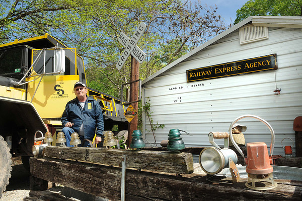 Eddie Goddard, of Brooks, in front his HO scale model railroad display building.<br /> Rick Barbero/The Register-Herald