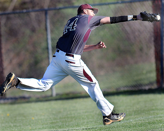 Woodrow Wilson Rightfielder #44 makes a snowcone catch for an out during Wednesday evening's game against George Washington in Beckley.F. Brian Ferguson/The Register-Herald