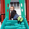 Christian Wilson's, 3, son of Nicole Sherrard, of Beaver, plays on the playground at Thornhill Courts on Second Street in Beckley Monday afternoon.<br /> Rick Barbero/The Register-Herald