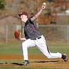 Flying Eagles pitcher Brady Knapp delivers against James Monroe Monday evening at Woodrow Wilson High.<br /> Brad Davis/The Register-Herald