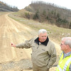Dave Tolliver, Raleigh County Commissioner, left, speaks with David Goddard, project supervisor WV Department of Highways on the Coalfield Expressway site<br /> Rick Barbero/The Register-Herald