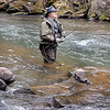 Veteran fly fisherman Lonnie Belmont, of Oak Hill, wades the chilly, spring waters of Dunloup Creek, in Fayette County, as he casts his line for Brown Trout. Belmont got sneak in some fly fishing between Wednesday morning storms. F. Brian Ferguson/The Register-Herald